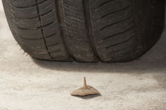 Nail and tyre Stock Photos