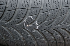 Nail in tyre Stock Photos