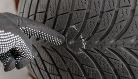 Nail in tyre Stock Photography