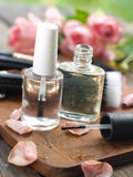 Nail varnish. Bottles with rose petals, selective focus Royalty Free Stock Photos