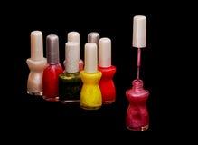 Nail varnish, polish, color - assorted bottles over black Stock Image