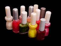 Nail varnish, polish, color - assorted bottles over black Royalty Free Stock Images