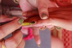 Nail varnish. Technique of nail varnish at the finger Royalty Free Stock Photos