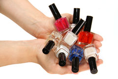 Nail varnish vials in hands Royalty Free Stock Images