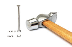 Nail which mark checkbox and hammer on white. Nail which mark checkbox and hammer isolated on white Royalty Free Stock Photos