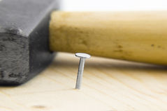 Nail in wood and Hammer Stock Photography