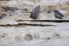 Iron objects in wood Royalty Free Stock Photography