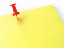 Nail on yellow paper. Write something on it Stock Image