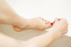 Nailcare. While applying the polish to toenails Stock Photo