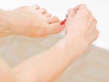 Nailcare. While applying the polish to toenails Royalty Free Stock Photos