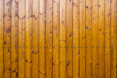 Nailed brown fence lining. Nailed brown wooden fence lining royalty free stock photos