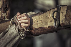 Nailed hand on wooden cross Royalty Free Stock Photos