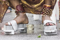 NAILED SANDALS. A Hindu man is wearing nailed sandals in Brickfields, Kuala Lumpur, Malaysia as part of his devotion royalty free stock image