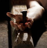 Nailed to the cross. Hand nailed to the cross with blood and dirt Stock Photography