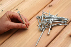 Nailing. New cedar decking royalty free stock image