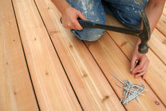 Nailing. Building a new deck stock images