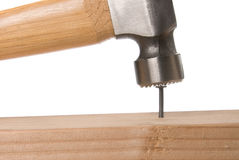 Nailing with hammer Stock Image