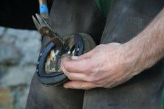 Nailing the hosrseshoe Stock Images