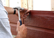 Nailing siding Stock Image