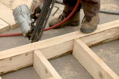 Nailing studs. On house frame Stock Images