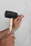 Nailing wall. Rubber mallet nail object the work of occupational safety hand work Royalty Free Stock Photos