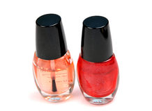 Nailpaint. Bottles isolated on white.It is applied by the females to enhance the nails beauty Royalty Free Stock Photo