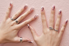 Nails. Female hands with crazy colored decorated manicured nails Stock Photos