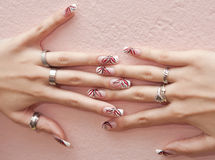 Nails. Female hands with crazy colored decorated manicured nails Royalty Free Stock Images