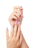 Nails. Two hands with long beautiful nails, on white background royalty free stock photos