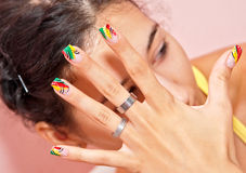 Nails. Female hands with crazy colored decorated manicured nails. Jewelry, such as rings are inevitable addition on woman's hands Royalty Free Stock Photos