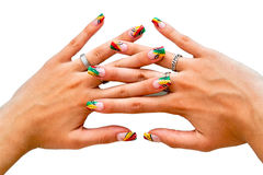 Nails. Female hands with crazy colored decorated manicured nails. Jewelry, such as rings are inevitable addition on woman's hands Stock Image