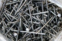 Nails for carpentry. Lots of nails in a plastic bag, ready to use in carpentry work Stock Images