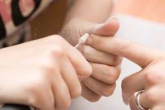 Nails correction stock photo