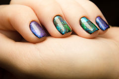 Nails. The design of broken glass. design of space Beautiful matte manicure. Combined manicure. Covering nail gel polish Stock Photos