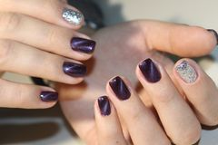 Nails. The design of broken glass. Beautiful matte manicure. Combined manicure Royalty Free Stock Images