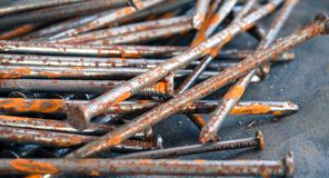 Nails detail. Shot of rusty nails on jeans - detail Royalty Free Stock Photos