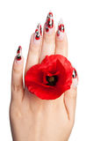 Nails and flower. Female hand with beautiful nails holds a red flower between fingers, on a white background stock photos