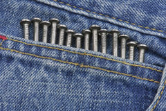 Nails inside jeans pocket Stock Image