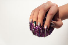 Nails lacquered in fun Christmas style. On the ring finger paint Stock Images