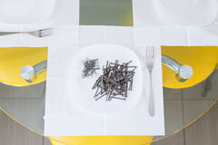 Nails lying on the plate.napkins.serving Royalty Free Stock Photo