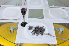 Nails lying on the plate.serving Stock Image