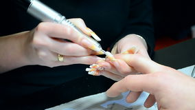 Nails manicure in beauty salon, technology closeup, stock video footage