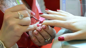 Nails manicure with red acryl in beauty salon, stock video footage