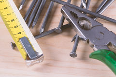 Nails, measuring tape and pliers Stock Image