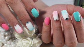 Nails with nail Polish rainbow stock images