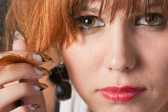 Nails near the face. Woman's face and nails close up Royalty Free Stock Image