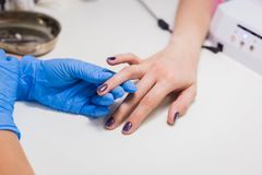 Nails painting with brush in nail salon Stock Images