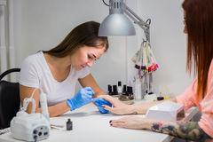 Nails painting with brush in nail salon Stock Photo