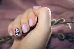 Fluffy buds and fluffy panda in the picture on a nail Stock Photo