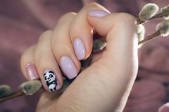 Manicure pastel color with a picture of a cute panda Royalty Free Stock Image